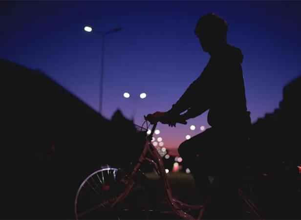 on bike at night